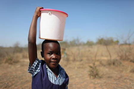 2011_A girl collects water in Zimbabwe_Credit Josh Estey.JPG